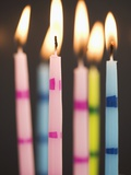 Six Lit Birthday Candles