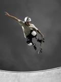 Skateboarder Performing Tricks