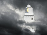Lighthouse Emerging From Dark Clouds
