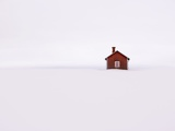 Red Wooden House Surrounded by Snow
