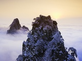 Mountain Peaks Above Clouds