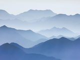 Yellow Mountains silhouetted in haze in China