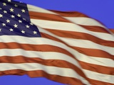 American flag unfurled by strong wind