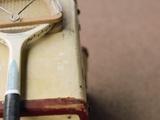 Old Tennis Racket on Suitcase