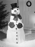 Dapper Snowman Outside a House