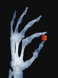 Skeletal Hand Holding Computer Chip Papier Photo par Charles O'Rear