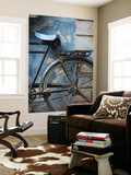 Bicycle Leaning Against Painted Wall