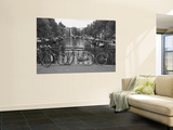 Bicycle Leaning Against a Metal Railing on a Bridge  Amsterdam  Netherlands