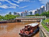 Skyline and Tug Boats on River  Singapore