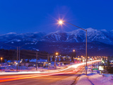 Traffic Flows into Town on Highway 93 at Dusk in Winter in Whitefish  Montana  Usa