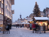 Christmas Tree With Stalls and People at Marktstrasse in the Spa Town of Bad Tolz  Bavaria