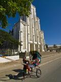 Man With a Rickshaw in Front of a Modern Church in Mahajanga  Madagascar  Africa