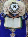 Muslim Man Reading the Quran in Mosque  Ho Chi Minh City  Vietnam  Indochina  Southeast Asia  Asia