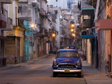 View Along Quiet Street at Dawn Showing Old American Car and Street Lights Still On  Havana  Cuba