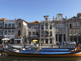 Moliceiro Boats Docked by Art Nouveau Style Buildings Along the Central Canal  Aveiro  Beira Litora