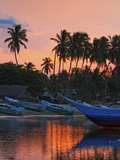 Boats and Palm Trees at Sunset at This Fishing Beach and Popular Tourist Surf Spot  Arugam Bay  Eas