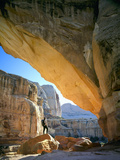 Hiker Below Natural Navajo Sandstone Hickman Bridge  Capitol Reef National Park  Utah  Usa