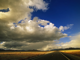 A Desert Highway Stretches Toward the Mountains