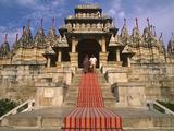 India  Rajasthan  Ranakpur  a Couple Descend Steps at the Famous Chaumukha Mandir  an Elaborately S