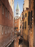 Campanile and Gondola on Canal in Venice  Italy