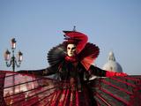 Venice  Veneto  Italy  a Mask in Costume on the Bacino Di San Marco with the Cupola of Santa Maria