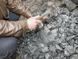 A Man Breaks Up Coal for Domestic Use  China