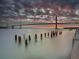 Bay Bridge and Old  Weathered Pier Pilings at Sunrise  San Francisco  California  USA