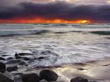 First Light of Dawn Streaming Through a Rain Squall on a Beach in the Pololu Vally  Big Island  USA