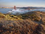 Fog Partially Enveloping the Golden Gate Bridge over San Francisco Bay