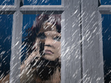 Person Looking Out of a Window on a Rainy Day
