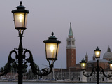 Lampposts Lit Up at Dusk with Building in the Background  San Giorgio Maggiore  Venice  Italy