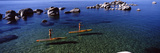 Two Women Paddle Boarding in a Lake  Lake Tahoe  California  USA
