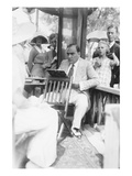 Enrico Caruso Leans Back on Chair Holding a Board with Music