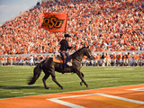 Oklahoma State University - The Cowboy Enters Boone Pickens Stadium