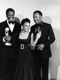 Actress Eartha Kitt poses with Sidney Portier and Raymond St Jacques at the NACCP Awards Banquet i