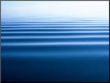 Small Gentle Ripples Move Across the Calm Surface of the Arctic Ocean