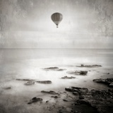 A Hot Air Balloon Floating Above the Sea