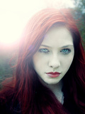 Girl with Red Hair and Light Behind Her