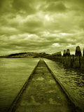 A Concrete Jetty on Water under a Stormy Sky