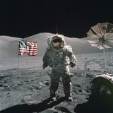 Apollo 17 Astronaut Stands Between US Flag and Lunar Rover  Dec 12  1971