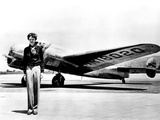 Amelia Earhart Standing in Front of the Lockheed Electra in Which She Disappeared in July 29  1937