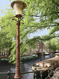 Old Gas Lamp Post and Bicycles on a Bridge over a Canal in Amsterdam  the Netherlands