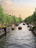 Boats Cruise Along a Canal with the Zuiderkerk Bell-Tower in the Background  Amsterdam  Netherlands