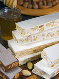 Turron (Spain)  Torrone (Italy) or Nougat (Morocco)  Confection of Honey  Sugar  Egg White and Nuts