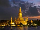 Buddhist Temple Lit Up at Dawn  Wat Arun  Chao Phraya River  Bangkok  Thailand