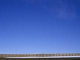 A Long Fence under a Blue Sky