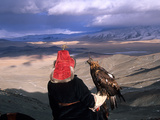 A Kazakh Eagle Hunter with His Bird in the Winter