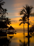 Sunset Scene with Infinity Pool and Trees Overlooking the Java Sea