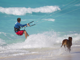 A Kiteboarder and His Dog Enjoying Gusty Winds from Hurricane Tomas