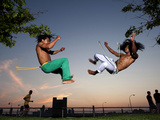 Two Young Brazilian Men Practice Capoeira in a NY Park at Sunset